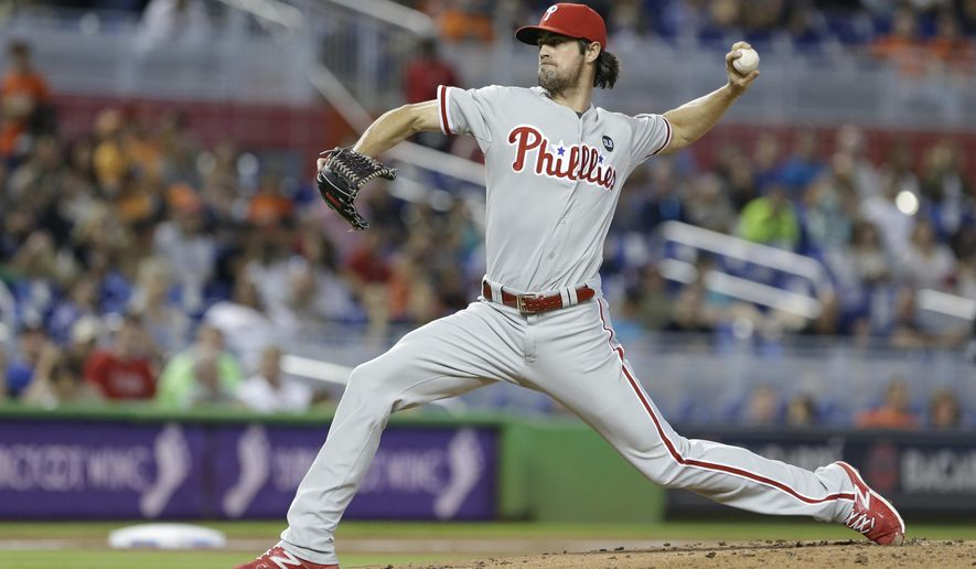 Philadelphia Phillies' Cole Hamels delivers a pitch during the first inning of a baseball game against the Miami Marlins, Saturday, May 2, 2015 in Miami. (AP Photo/Wilfredo Lee)