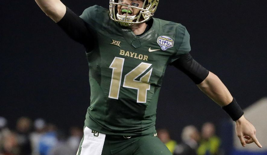 FILE - In this Jan. 1, 2015, file photo, Baylor quarterback Bryce Petty (14) celebrates a touchdown pass during the second half of the Cotton Bowl NCAA college football game against Michigan State in Arlington, Texas. The New York Jets have drafted Petty with their fourth-round pick, moving up one spot Saturday, May 1, 2015, in a trade with the Jacksonville Jaguars. (AP Photo/LM Otero, File)