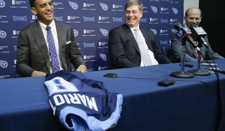 Marcus Mariota, left, former Oregon quarterback and overall No. 2 NFL football draft pick by the Tennessee Titans, answers questions during a news conference Friday, May 1, 2015, in Nashville, Tenn. With Mariota are Titans general manager Ruston Webster, center, and head coach Ken Whisenhunt, right. Mariota was selected by the Titans in the first round Thursday. (AP Photo/Mark Humphrey)