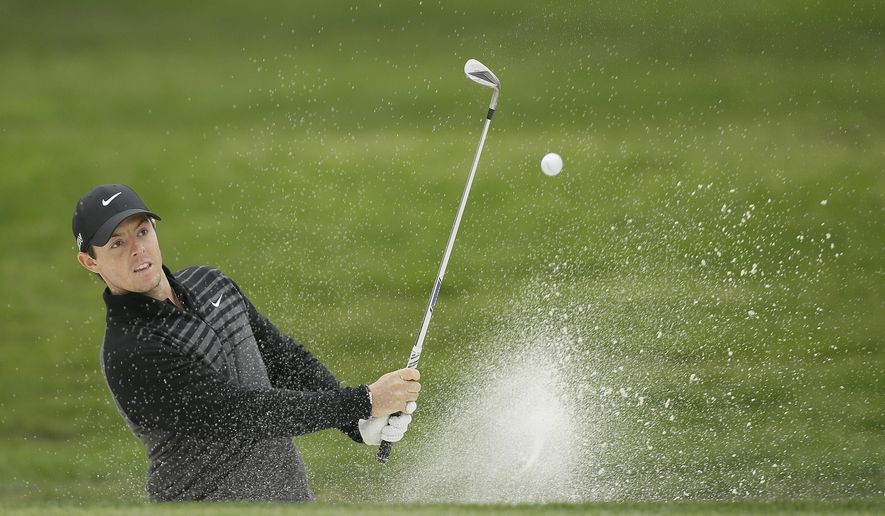 Rory McIlroy of Northern Ireland hits out of a bunker up to the 15th green of TPC Harding Park during round-robin play against Billy Horschel at the Match Play Championship golf tournament Friday, May 1, 2015, in San Francisco. McIlroy won the match on the 20th hole. (AP Photo/Eric Risberg)