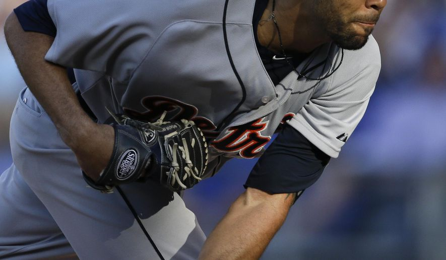 Detroit Tigers starting pitcher David Price delivers to a Kansas City Royals batter during the first inning of a baseball game at Kauffman Stadium in Kansas City, Mo., Saturday, May 2, 2015. (AP Photo/Orlin Wagner)