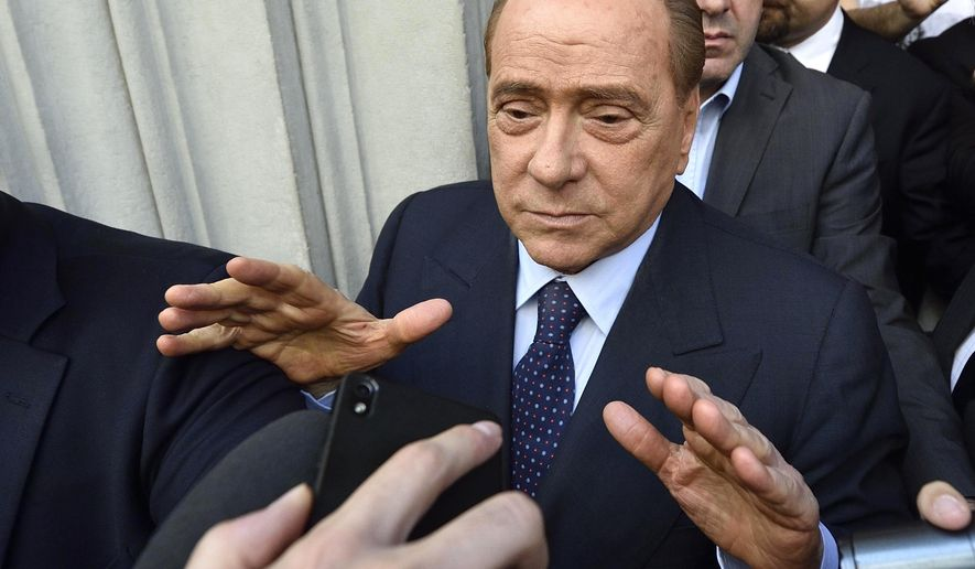 Silvio Berlusconi meets journalists in Milan, Italy, Saturday, May 2, 2015. AC Milan President Silvio Berlusconi says he may retain a majority stake of the club, in his first comments about a potential sale of the team he has owned for nearly 30 years. Berlusconi met with Bee Taechaubol on Saturday at the Thai businessman's hotel in central Milan to continue negotiations, which have intensified this week. (Flavio Lo Scalzo/Ansa via AP)