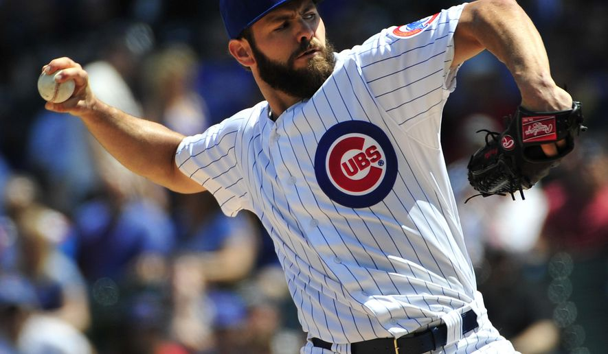 Chicago Cubs starting pitcher Jake Arrieta throws against the Milwaukee Brewers during the first inning of a baseball game, Saturday, May 2, 2015 in Chicago. (AP Photo/David Banks)