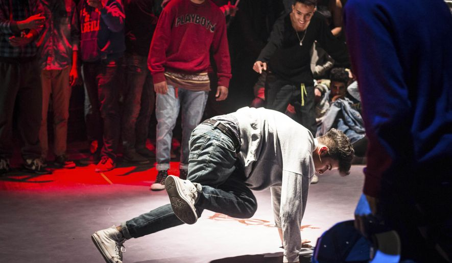 In this photo taken Jan.10, 2015, a break dancer performs in Sousse, Tunisia. Tunisian youth are getting out their message of rage about life on the fringes in post-revolution Tunisia through a perhaps surprising channel: hip hop. (AP Photo/Nicholas Linn)