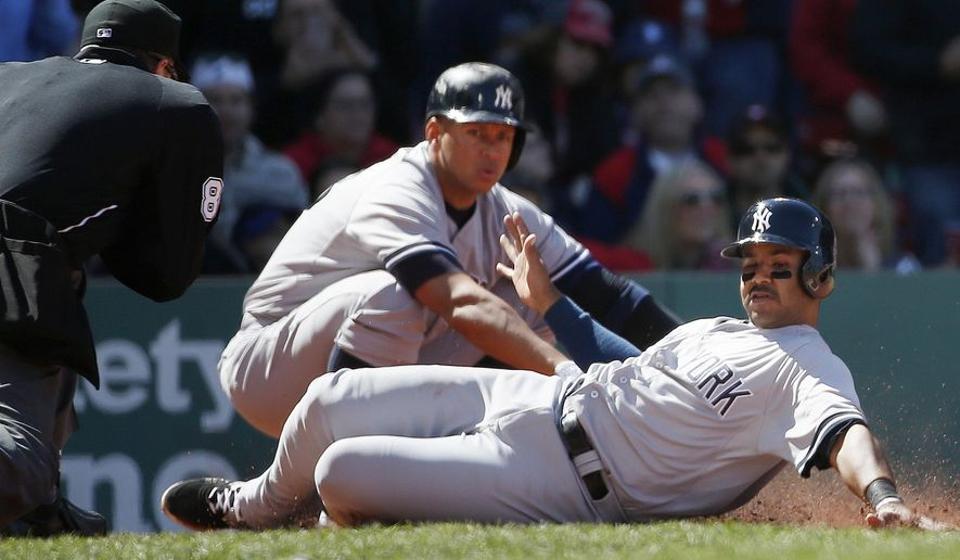 New York Yankees' Gregorio Petit, right, scores on a single by Brett Gardner as Alex Rodriguez, behind, looks on during the fifth inning of a baseball game against the Boston Red Sox in Boston, Saturday, May 2, 2015. (AP Photo/Michael Dwyer)