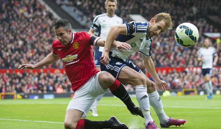 Manchester United's Robin van Persie, left, fights for the ball against West Bromwich Albion's Craig Dawson during the English Premier League soccer match between Manchester United and West Bromwich Albion at Old Trafford Stadium, Manchester, England, Saturday, May 2, 2015. (AP Photo/Jon Super)