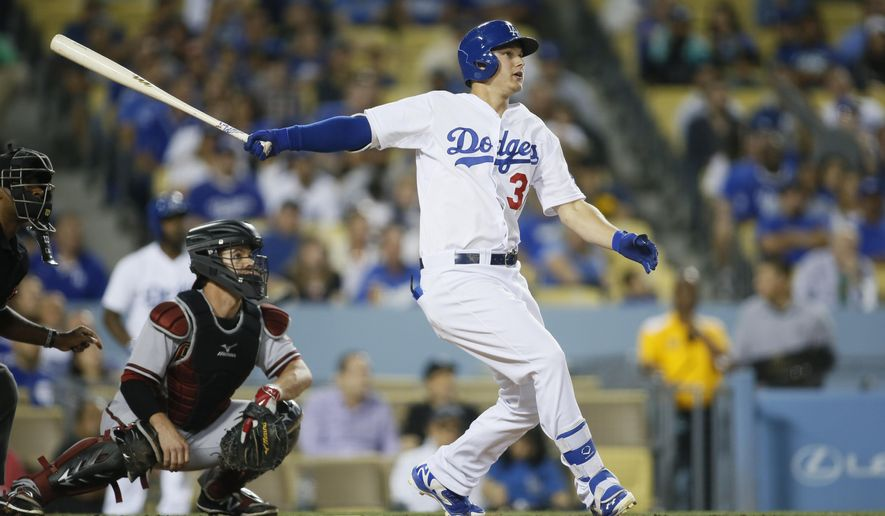 Los Angeles Dodgers' Joc Pederson, right, hits a grand slam in front of Arizona Diamondbacks catcher Tuffy Gosewisch, also scoring Andre Ethier, Yasmani Grandal and Alex Guerrero, during the second inning of a baseball game, Friday, May 1, 2015, in Los Angeles. (AP Photo/Danny Moloshok)