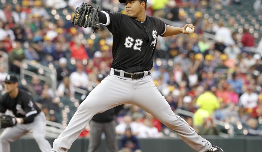 Chicago White Sox starting pitcher Jose Quintana (62) delivers to the Minnesota Twins during the first inning a baseball game in Minneapolis, Friday, May 1, 2015. (AP Photo/Ann Heisenfelt)