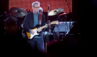 """Eric Clapton, center, performs during his """"70th Birthday Celebration"""" concert at Madison Square Garden on Friday, May 1, 2015, in New York. (Luiz C. Ribeiro/Invision/AP) ** FILE **"""