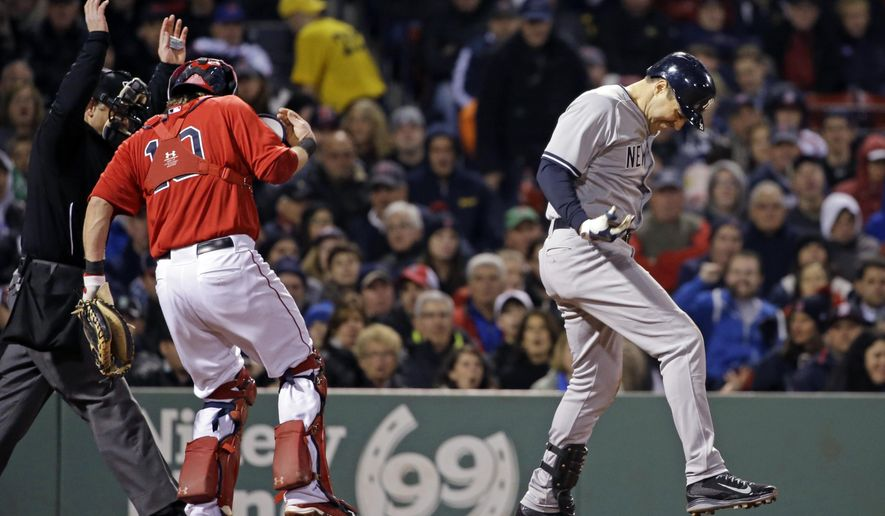 Both New York Yankees' Mark Teixeira and Boston Red Sox catcher Ryan Hanigan react after being hit in the hands by the same pitch in the seventh inning of a baseball game against the Boston Red Sox at Fenway Park in Boston, Friday, May 1, 2015. (AP Photo/Elise Amendola)