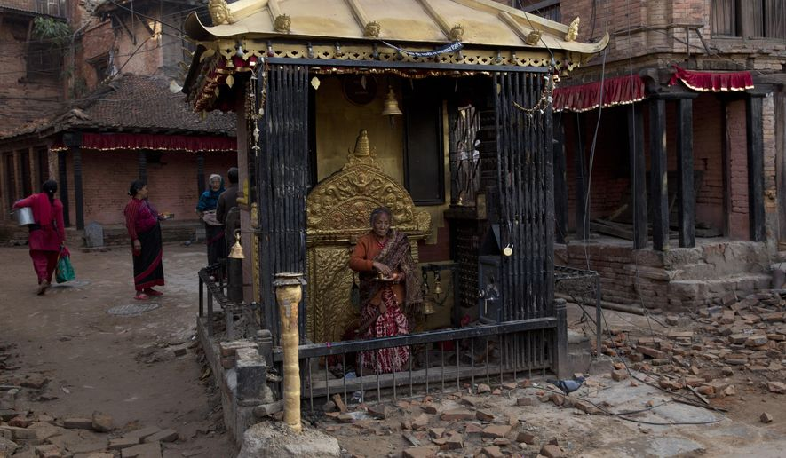 Elderly Nepalese visit a temple in Bhaktapur, Nepal, Saturday, May 2, 2015. A week after the devastating earthquake, life is limping back to normal in Nepal with residents visiting temples on the first Saturday after the quake, a day normally reserved for temple visits. (AP Photo/Bernat Amangue)