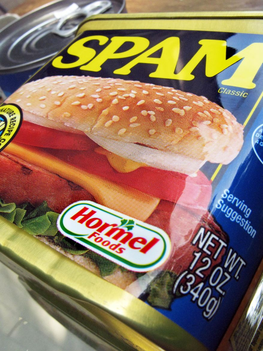FILE - In this Aug. 20, 2009 file photo, a can of Spam is shown on a counter in North Andover, Mass. To honor Spam lovers in Hawaii, Hormel Foods will release a new flavor, Portuguese sausage Spam, exclusively for the state at a street festival on Saturday, May 2, 2015 in Honolulu. The flavor, which will be available to sample at the event, may eventually be sold elsewhere in the region and internationally. (AP Photo/Elise Amendola, File)