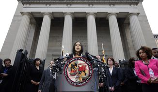 FILE - In this Friday, May 1, 2015 file photo, Marilyn Mosby, Baltimore's top prosecutor, speaks during a news conference in Baltimore. Mosby charged six officers in the death of Freddie Gray, who suffered a grave spinal injury as he was arrested and put into a police transport van, handcuffed and without a seat belt. But getting a jury to convict police officers of murder and manslaughter will be far harder than obtaining arrest warrants. (AP Photo/Alex Brandon)