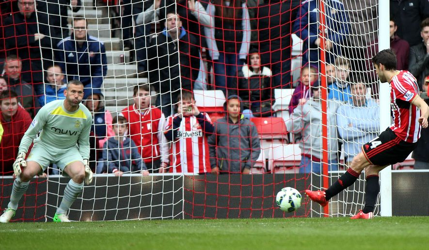 Sunderland's Jordi Gomez, right, scores his goal from a penalty kick past Southampton's goalkeeper Kelvin Davis, left, during their English Premier League soccer match between Sunderland and Southampton at the Stadium of Light, Sunderland, England, Saturday, May 2, 2015. (AP Photo/Scott Heppell)