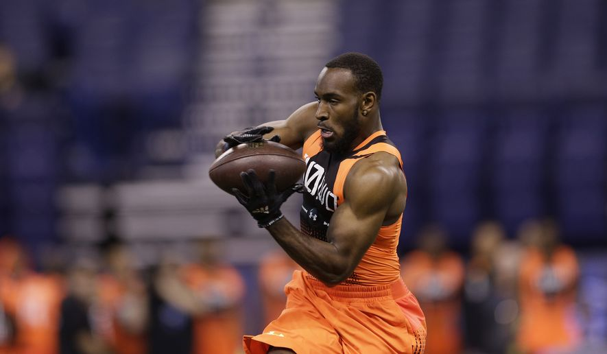 Duke wide receiver Jamison Crowder runs a drill at the NFL football scouting combine in Indianapolis, Saturday, Feb. 21, 2015. (AP Photo/David J. Phillip)