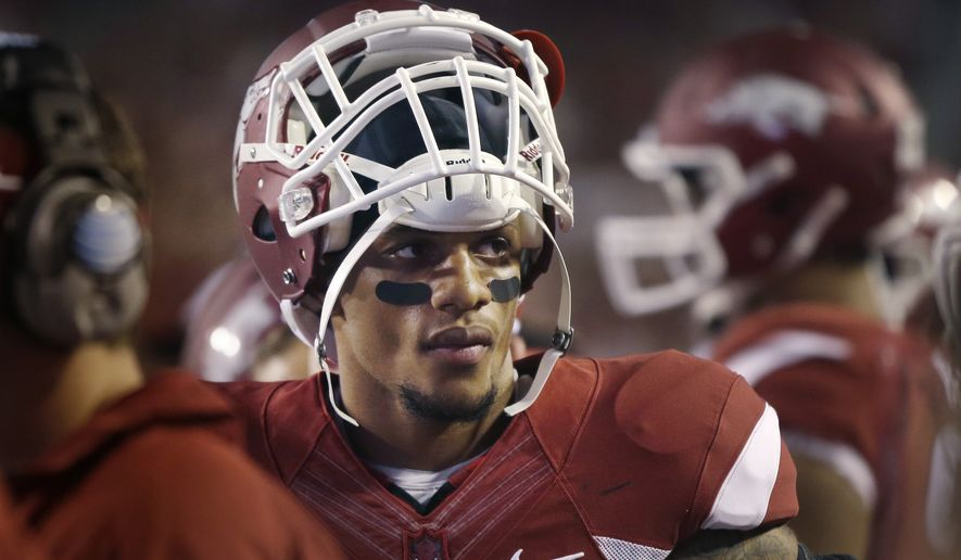 Arkansas cornerback Tevin Mitchel returns to the bench IN an NCAA college football game in Fayetteville, Ark., Saturday, Sept. 20, 2014. Arkansas defeated Northern Illinois 52-14. (AP Photo/Danny Johnston)