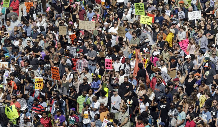 Protesters gather for a rally outside City Hall in Baltimore on Saturday, May 2, 2015, the day after charges were announced against the police officers involved in Freddie Gray's death. (AP Photo/Patrick Semansky)