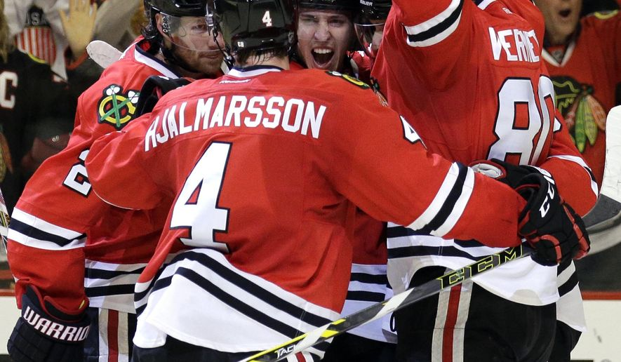 Chicago Blackhawks center Teuvo Teravainen (86), center, celebrates with teammates after scoring his goal during the second period of Game 1 in the second round of the NHL Stanley Cup hockey playoffs against the Minnesota Wild in Chicago, Friday, May 1, 2015. (AP Photo/Nam Y. Huh)