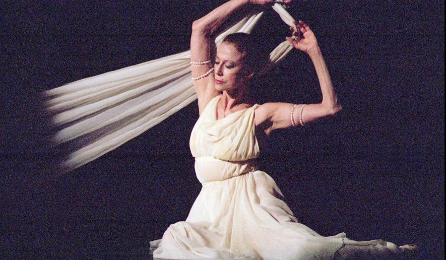 "FILE - In this photo made in March 3, 1996, 70-year-old world ballet legend Maya Plisetskaya performs ""Isadora Duncan,"" a one-act ballet, dedicated to the great American dancer, during her only Ukraine concert at the National Ballet Theater in Kiev, Ukraine.  Maya Plisetskaya, 89, widely regarded as one of the greatest ballerinas of her time, died Saturday, May 2, 2015, from a heart attack in Germany, according to an announcement by famous ballet dancer Mikhail Baryshnikov, and Russian Prime Minister Dmitry Medvedev offered condolences on the death. (AP Photo/Efrem Lukatsky)"