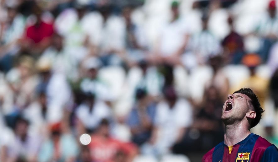 Barcelona's Lionel Messi gestures during a Spanish La Liga soccer match between Cordoba and FC Barcelona at El Arcangel stadium in Cordoba, Spain, Saturday May 2, 2015. (AP Photo/Daniel Tejedor)