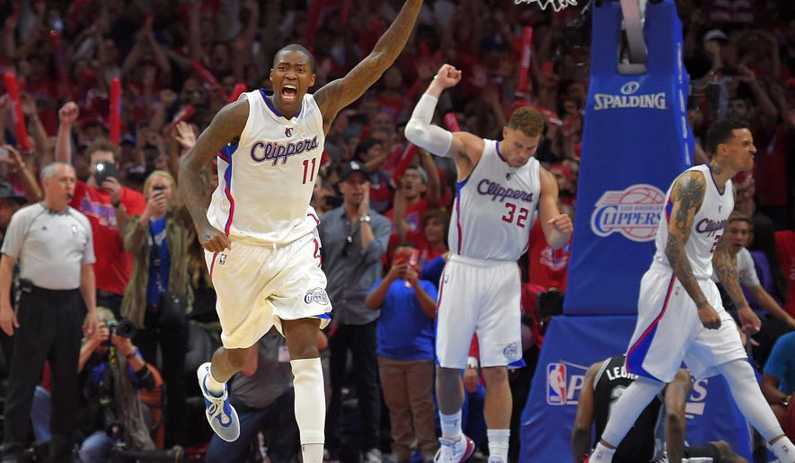 Los Angeles Clippers guard Jamal Crawford, front left, celebrates along with forward Blake Griffin, center, and forward Matt Barnes after they defeated the San Antonio Spurs in Game 7 in a first-round NBA basketball playoff series, Saturday, May 2, 2015, in Los Angeles. The Clippers won 111-109. (AP Photo/Mark J. Terrill)