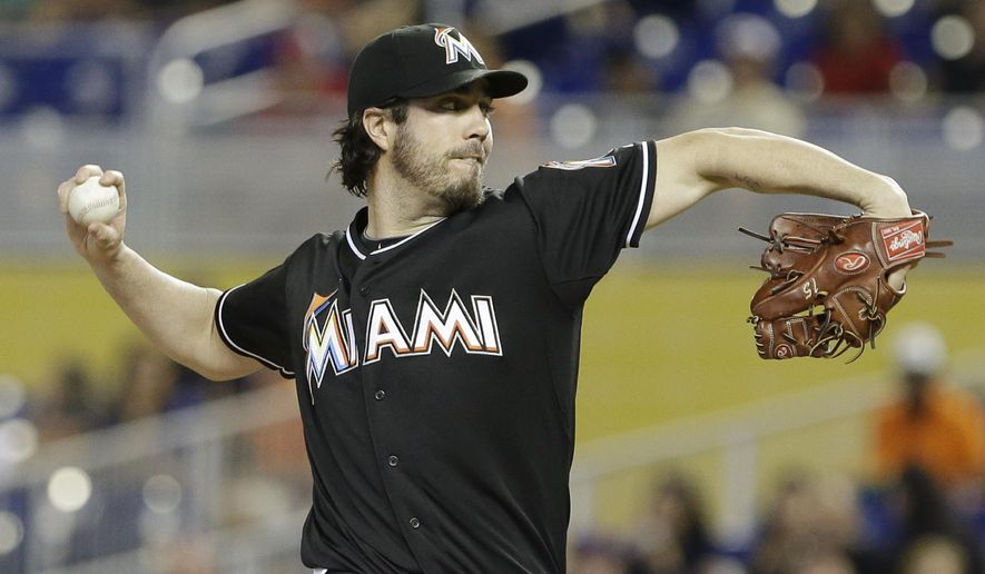 Miami Marlins' Dan Haren delivers a pitch during the first inning of a baseball game against the Philadelphia Phillies, Saturday, May 2, 2015 in Miami. (AP Photo/Wilfredo Lee)