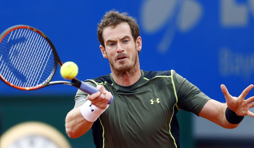 Britain's Andy Murray returns the ball to Lukas Rosol from Czech Republic during the quarterfinal match at the BMW Open tennis tournament in Munich, Germany, on Saturday, May 2, 2015. (AP Photo/Matthias Schrader)