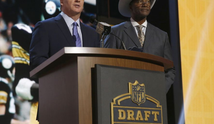 NFL commissioner Roger Goodell introduces former Pittsburgh Steelers cornerback Mel Blount as Blount announces the Steelers selects Mississippi defensive back Senquez Golson as the 56th pick in the second round of the 2015 NFL Football Draft,  Friday, May 1, 2015, in Chicago. (AP Photo/Charles Rex Arbogast)