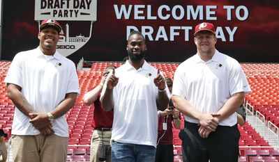 Washington Redskins NFL football draft picks, from left, linebacker Preston Smith, running back Matt Jones, and offensive lineman Brandon Scherff, pause for a photograph during a draft day party Saturday, May 2, 2015, in Landover, Md. (AP Photo/Alex Brandon)