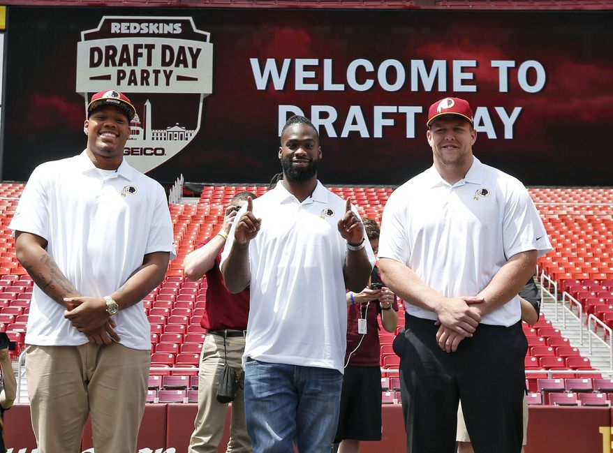 Washington Redskins NFL football draft picks, from left, linebacker Preston Smith, running back Matt Jones, and offensive lineman Brandon Scherff, pause for a photograph during a draft day party Saturday, May 2, 2015, in Landover, Md. (AP Photo/Alex Brandon) ** FILE **