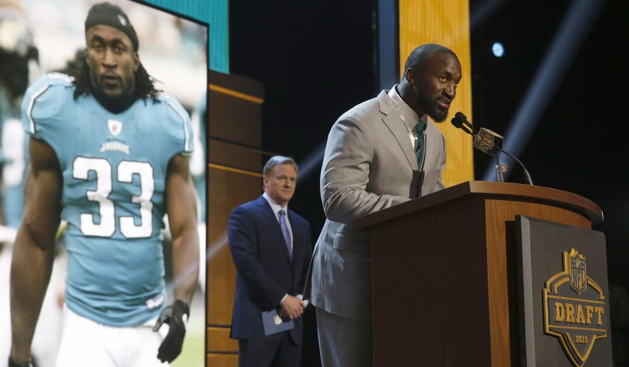 Former NFL player Greg Jones announces that the Jacksonville Jaguars selects Alabama running back T.J. Yeldon as the 36th pick in the second round of the 2015 NFL Football Draft,  Friday, May 1, 2015, in Chicago. (AP Photo/Charles Rex Arbogast)