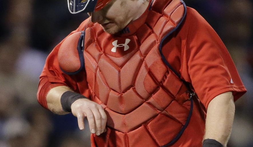 """Boston Red Sox catcher Ryan Hanigan looks at his hand as he leaves in the seventh inning of a baseball game at Fenway Park in Boston, Friday, May 1, 2015 after being hit by a pitch from reliever Tommy Layne which first hit New York Yankees batter Mark Teixeira. Red Sox manager John Farrell said Hanigan sustained a broken knuckle that will require surgery and cause a """"lengthy"""" absence. (AP Photo/Elise Amendola)"""