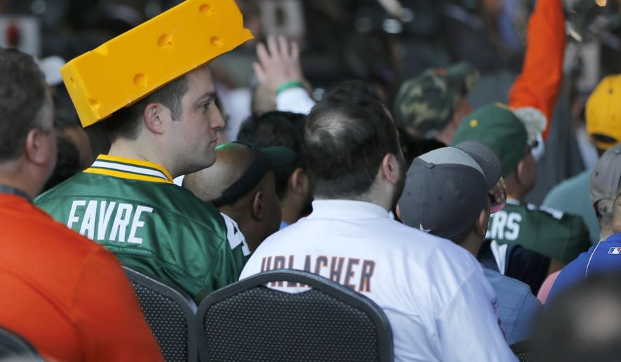 A Green Bay Packers and a Chicago Bears football fan sit together during the last day of the 2015 NFL Draft,   Saturday, May 2, 2015, in Chicago. (AP Photo/Charles Rex Arbogast)