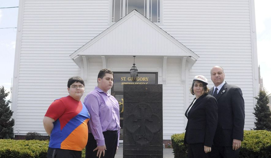 MEMBER FEATURE EXCHANGE ADVANCE FOR MAY 2 -- In this April 24, 2015 photo, Susan Hazarvartian second from from right, stands with her sons Deran, left, Drtad, second from left, and husband Kim, right, in front of the Saint Gregory Armenian Apostolic Church in Andover, Mass. Susan Hazarvartian's grandmother had siblings and parents killed in the Armenian Genocide (Paul Bilodeau/The Eagle-Tribune via AP)