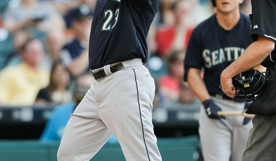 Seattle Mariners right fielder Nelson Cruz (23) celebrates after hitting a home run in the second inning against the Houston Astros in a baseball game Saturday May 2, 2015 in Houston. (AP Photo/Bob Levey)