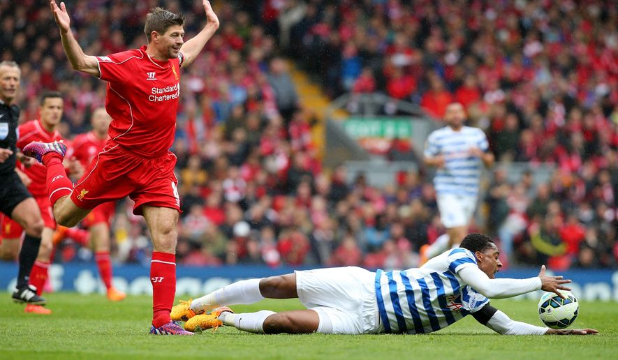 Liverpool's Steven Gerrard, left, and Queens Park Rangers' Leroy Fer battle for the ball during their English Premier League soccer match at Anfield, Liverpool, England, Saturday, May 2, 2015. (Peter Byrne/PA via AP)     UNITED KINGDOM OUT      -      NO SALES     -    NO ARCHIVES
