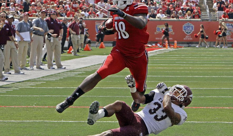 FILE - In this Sept. 7, 2013, file photo, Louisville tight end Gerald Christian (18) slips away from Eastern Kentucky's Jason Fergerson (33) after making a catch in the second quarter of anir NCAA college football game in Louisville, Ky. With the 256th , and last, pick of the three-day NFL football draft, the Arizona Cardinals chose Christian on Saturday, May 2, 2015. He was 10th Louisville player chosen in the draft (AP Photo/Garry Jones, File)
