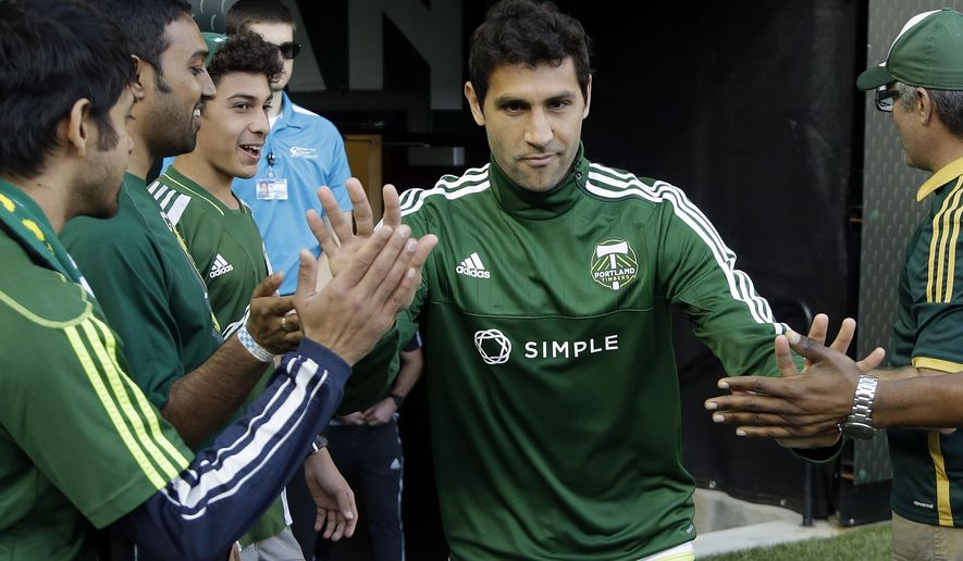 Portland Timbers midfielder Diego Valeri runs onto the field before an MLS soccer game against the Vancouver Whitecaps in Portland, Ore., Saturday, May 2, 2015.  The Argentine playmaker, who tore his ACL on the final day of the 2014 season against FC Dallas, is looking to play the first game since his injury. (AP Photo/Don Ryan)