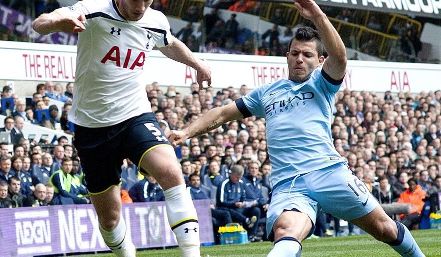 Tottenham Hotspurs's Jan Vertonghen, left, controls the ball in front of Manchester City's Sergio Aguero, during the English Premier League soccer match between Tottenham Hotspurs and Manchester City, at White Hart Lane Stadium in London, Sunday, May 3, 2015. (AP Photo/Bogdan Maran)
