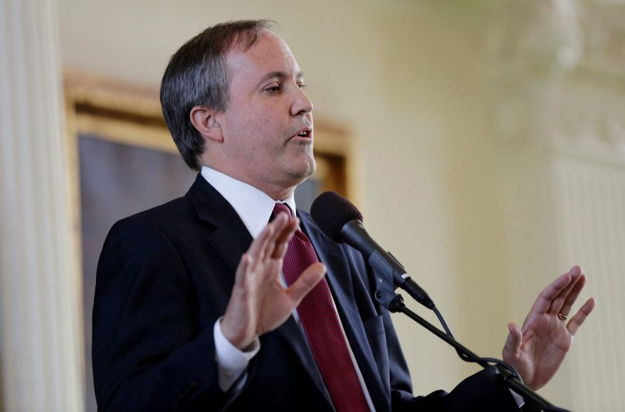"""""""We will continue to fight for the rule of law by asking the district court to carefully review the administration's withheld documents and hold the DOJ accountable so they provide reliable information about this case,"""" said Texas Attorney General Ken Paxton. (Associated Press)"""