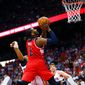The Wizards' John Wall goes up for a shot against in a 104-98 win over the Hawks in Game 1 of the Eastern Conference semifinals. (Associated Press)