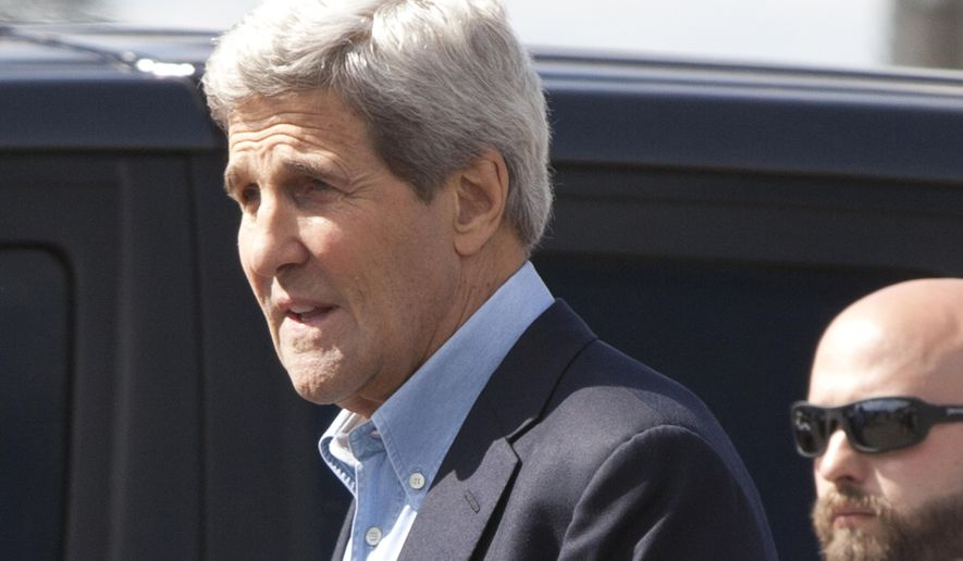 U.S. Secretary of State John Kerry, left, with his security, right, walks to his car as he arrives in Nairobi, Kenya, Sunday, May 3, 2015.  Kerry is visiting Sri Lanka, Kenya, and Djibouti on his trip. (AP Photo/Sayyid Azim)