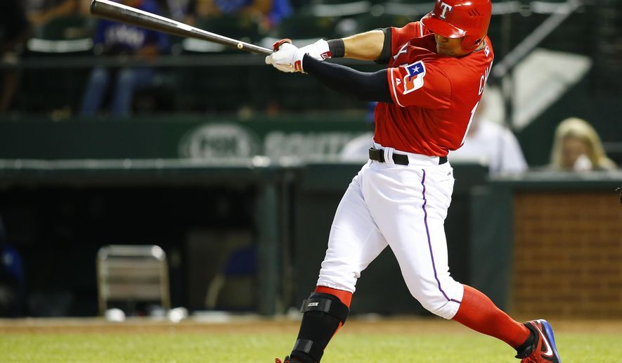 Texas Rangers' Shin-Soo Choo hits a three-run home run to tie the game against the Oakland Athletics in the eighth inning of a baseball game Saturday, May 2, 2015, in Arlington, Texas. (AP Photo/Mike Stone)
