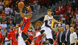 Washington Wizards guard Bradely Beal intercepts a pass from Atlanta Hawks guard Kyle Korver intended for Jeff Teague during an NBA second-round basketball payoff series game on Sunday, May 3, 2015, in Atlanta. Washington won 104-98. (Curtis Compton/Atlanta-Journal Constitution via AP) MARIETTA DAILY OUT, GWINNETT DAILY POST OUT, LOCAL TV OUT (WXIA, WGCL, FOX 5)