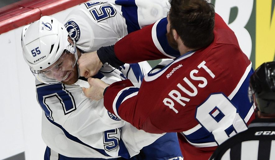 Montreal Canadiens winger Brandon Prust (8) fights with Tampa Bay Lightning defenceman Braydon Coburn (55) during third period of Game 2 NHL second round playoff hockey action Sunday, May 3, 2015 in Montreal.  (Ryan Remiorz(/The Canadian Press via AP)   MANDATORY CREDIT
