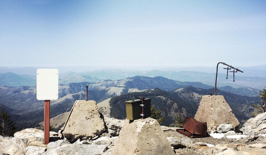 ADVANCE FOR MONDAY MAY 4 AND THEREAFTER - In an April 12, 2015 photo, the concrete foundations of a now-demolished fire lookout and an ammo can containing a waterproof guestbook top the summit of Wagner Butte, overlooking the Rogue Valley south of Talent, Ore.  The trail to the summit is a five-mile point-to-point hike from the trailhead on Wagner Creek Road. (Thomas Moriarty/The Mail Tribune via AP)