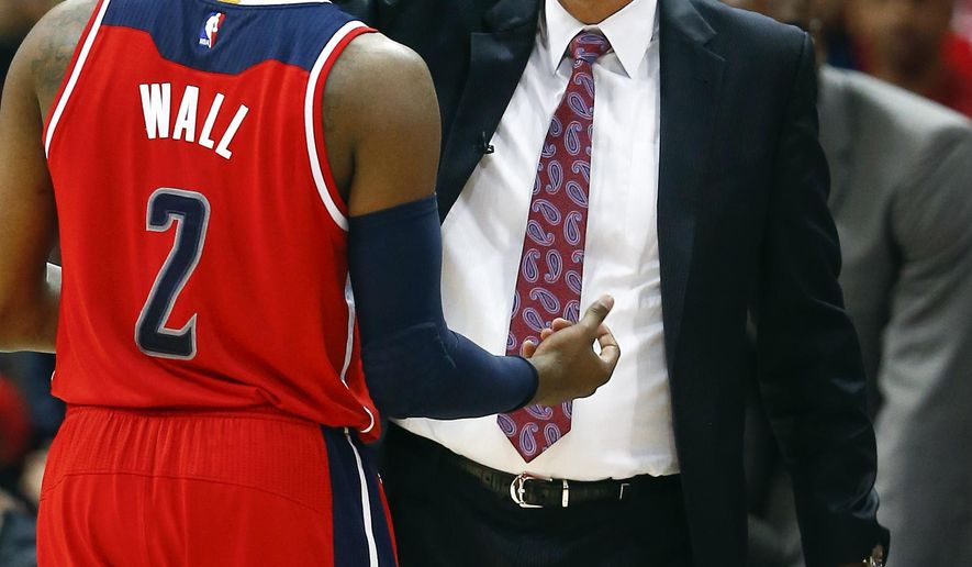 Washington Wizards head coach Randy Wittman talks with guard John Wall (2) in the second half of an NBA second-round basketball payoff series game against the Atlanta Hawks Sunday, May 3, 2015, in Atlanta. Washington won 104-98. (AP Photo/John Bazemore)