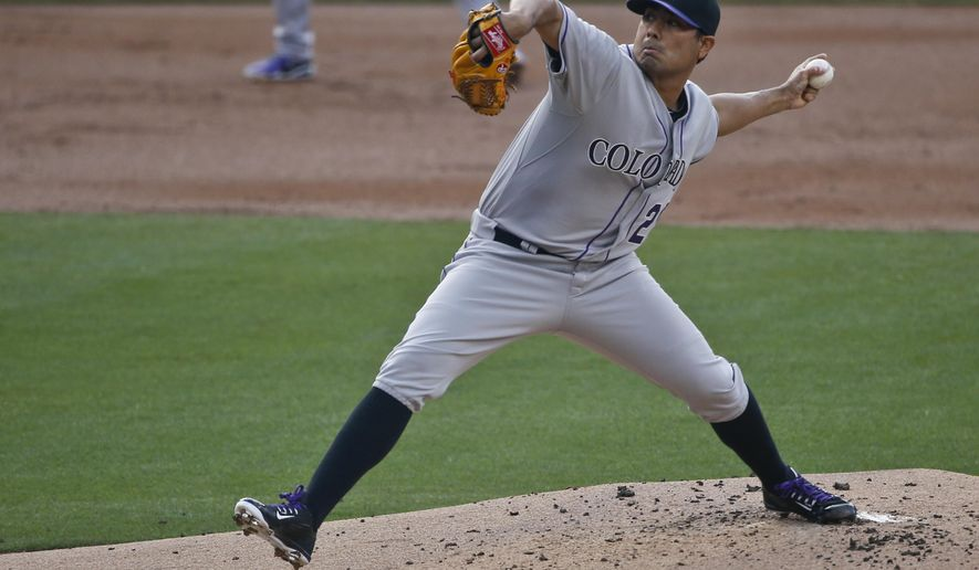 Colorado Rockies starting pitcher Jorge De La Rosa works  against the San Diego Padres in the first inning of a baseball game Saturday May 2, 2015 in San Diego. (AP Photo/Lenny Ignelzi)