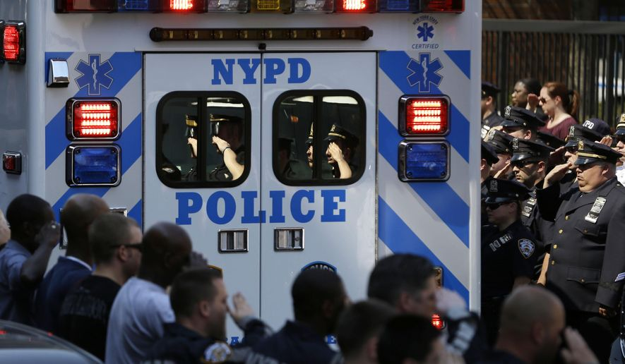 Police officers salute as the body of Brian Moore leaves Jamaica Hospital in New York, Monday, May 4, 2015. Moore, a 25-year-old police officer shot in the head over the weekend while attempting to stop a man suspected of carrying a handgun, has died from his injuries, the third New York Police Department officer slain in the line-of-duty in five months, a City Hall official said Monday. (AP Photo/Seth Wenig)