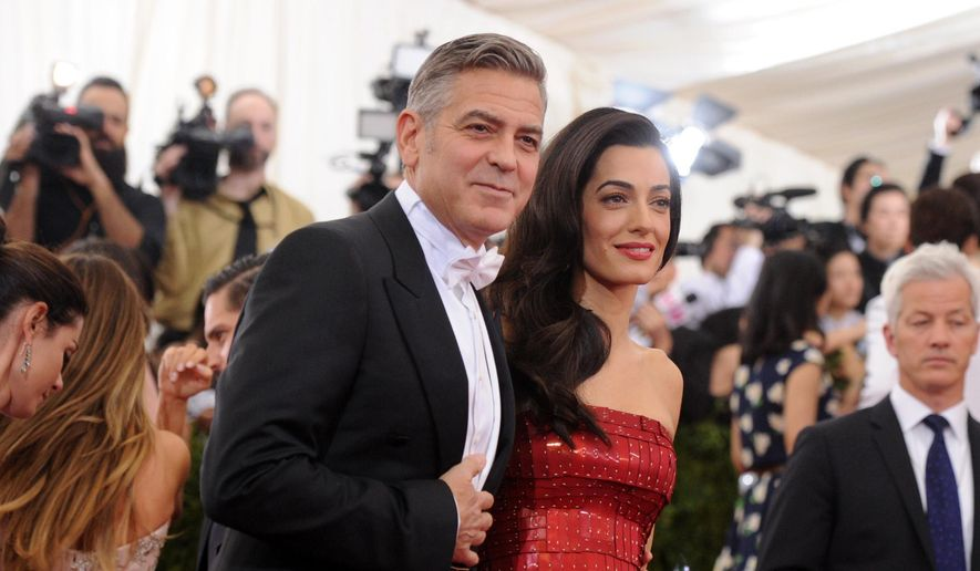 "George Clooney and Amal Clooney arrive at The Metropolitan Museum of Art's Costume Institute benefit gala celebrating ""China: Through the Looking Glass"" on Monday, May 4, 2015, in New York. (Photo by Evan Agostini/Invision/AP)"